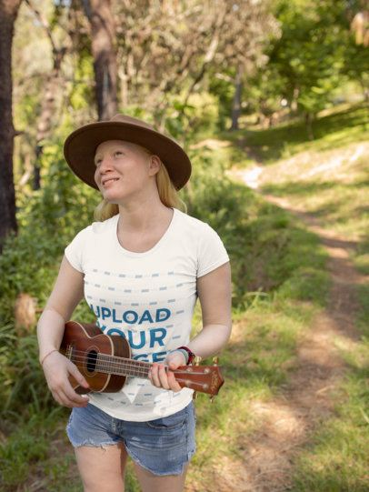 T-Shirt Mockup of a Girl Playing an Ukulele at a Forest 21992