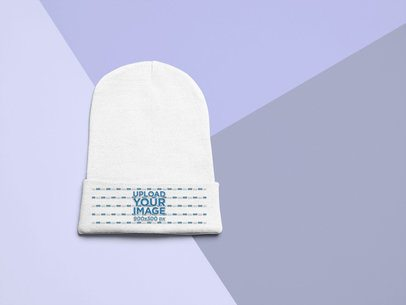 Flat Lay Mockup of a Cuffed Beanie on a Surface with Three Colors 24751