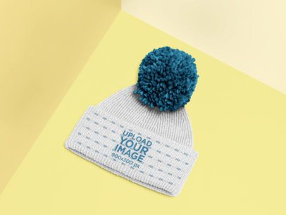 Mockup of a Beanie with a Pom Pom Against a Colorful Corner 25175