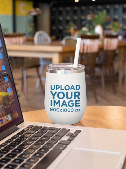 Mockup of a Tumbler on a Desk Next to a Laptop 24445