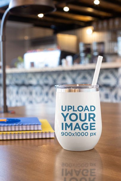 Mockup of a Tumbler with a Straw on a Wooden Surface 24447