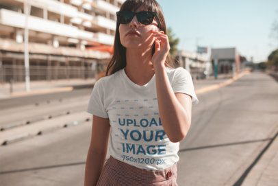 T-Shirt Mockup of a Girl Wearing a Round Neck Tee on the Street 19616