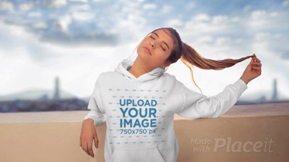 Parallax Video Featuring a Girl Wearing a Hoodie on a Rooftop 25449