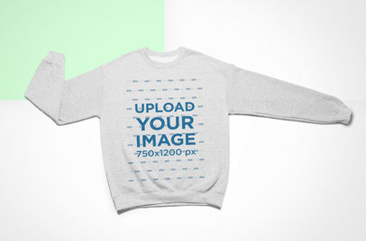 Flat Lay Mockup of a Crewneck Sweatshirt over a Colored Background 24760