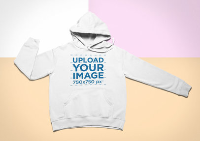 Mockup of a Pullover Hoodie Lying Flat on a Colorful Surface 24758