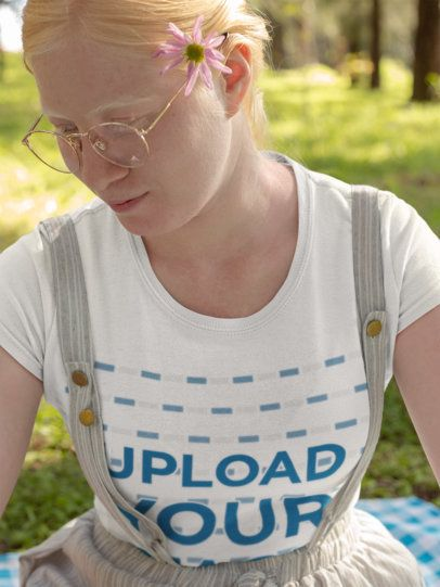Mockup of a Beautiful Girl with Glasses Wearing a T-Shirt in a Meadow 21999