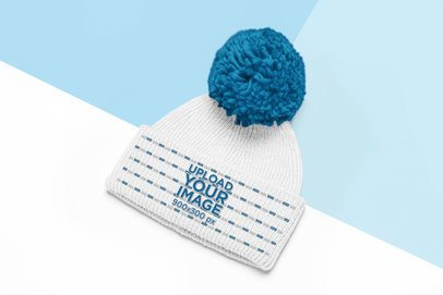 Cute Pom Pom Beanie Mockup with a Colored Background 24748