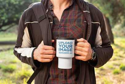 Mockup of a Man Hiking with His Travel Mug 24392