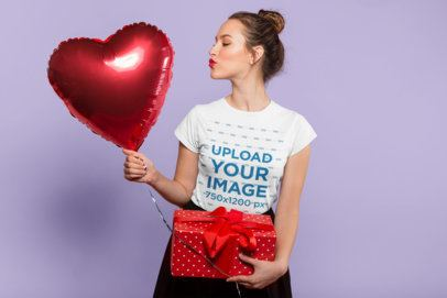 Valentine's Day Mockup of a Pretty Lady Wearing a T-Shirt Holding a Heart Balloon 25419