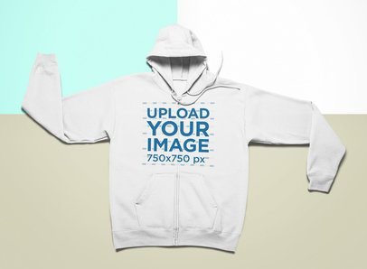 Mockup of a Zip Up Hoodie on a Surface with Three Colors 24757