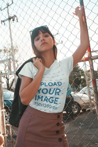 T-Shirt Mockup of a Girl Outside a Car Lot 19629