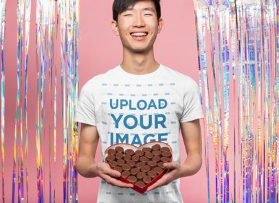 Valentine's Day T-Shirt Mockup of a Happy Man Holding a Box of Chocolates 25424