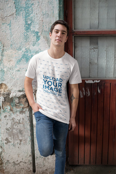 Mockup of a Man Wearing a T-Shirt While Leaning Against an Old Wall 25292