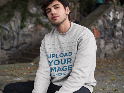 Mockup of a Cool Serious Man Wearing a Heathered Sweater Outdoors 18188