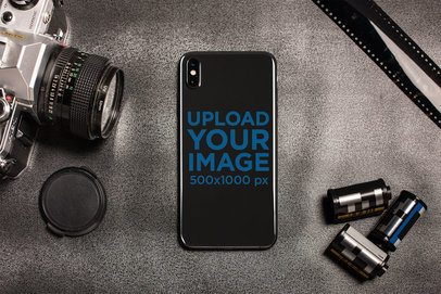 Mockup of a Phone Sticker Surrounded by Photography Accessories 25207