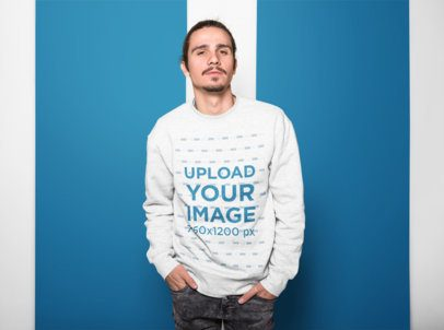 Sweatshirt Mockup of a Hipster Looking Man with a Colored Background 18519