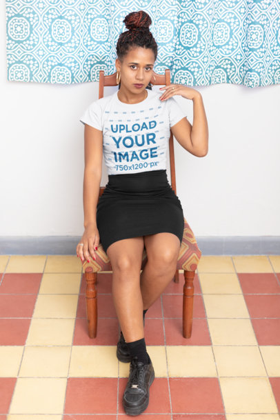 T-Shirt Mockup of a Girl with Locs Sitting on a Vintage Chair 24084