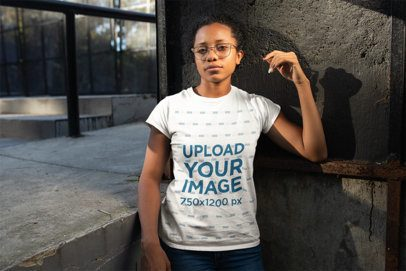 T-Shirt Mockup of a Girl with Glasses in an Urban Environment 24101