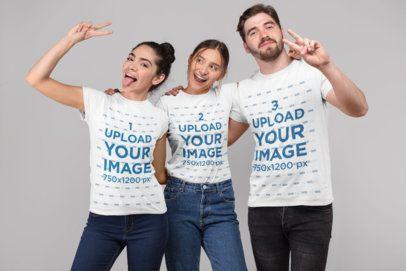 T-Shirt Mockup of Three Friends Having Fun in a Plain Studio 25700
