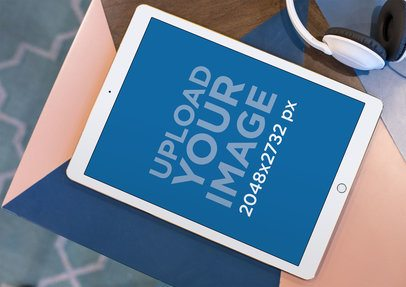Mockup of an iPad Lying on the Corner of a Multicolor Table 24723
