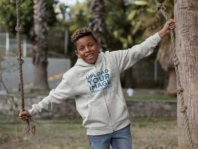 Full Zip Hoodie Mockup of a Kid Having Fun at a Park 24946