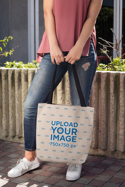 Mockup of a Woman Holding a Tote Bag 24824