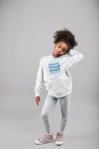 Mockup of a Little Girl With Kinky Hair Ponytail Posing with a Pullover Hoodie at a Studio 24858
