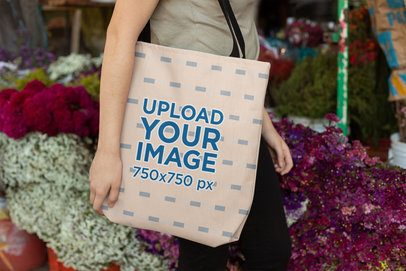 Mockup of a Woman Carrying a Tote Bag in Front of Flowers 24870