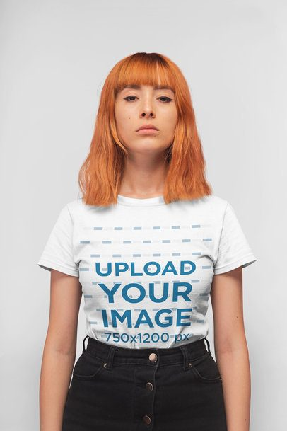 T-Shirt Mockup of a Serious Faced Girl Standing in a Studio 20844