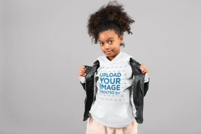 Mockup of a Little Girl with a Curly Ponytail Showing off Her Pullover Hoodie 24863