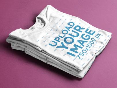 Folded T-Shirts Mockup Over a Flat Backdrop 6492a