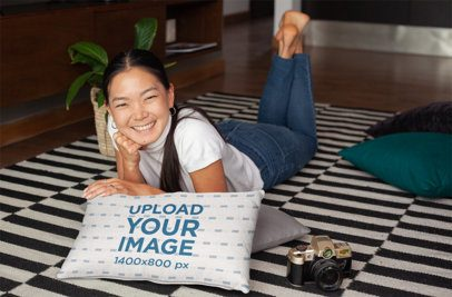 Pillow Mockup Featuring an Asian Woman Lying on a Rug 25909