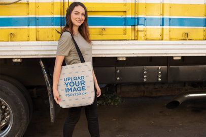 Tote Bag Mockup of a Woman Passing by a Parked Truck 24876