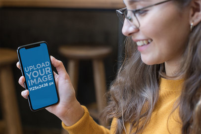 iPhone XS Mockup Featuring a Happy Girl with Glasses 25373