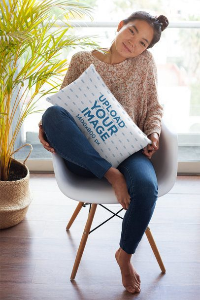 Pillow Mockup Featuring a Pretty Girl Sitting at Home 25905