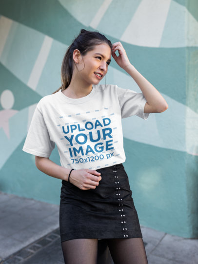 Tee Mockup of a Fashionable Girl Standing in Front of a Graffiti Wall 25780
