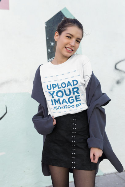 Mockup of a Coy Girl Wearing a T-Shirt Styled with a Black Skirt 25782