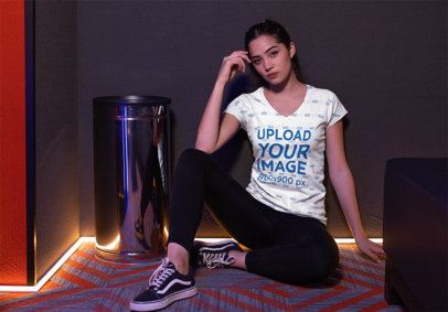 V-Neck Tee Mockup of a Girl Wearing Vans in a Led-Illuminated Corner 24929