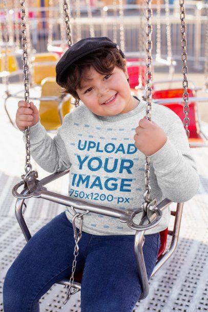 Plus Size Sweatshirt Mockup of a Joyful Kid on a Swing Ride 25557