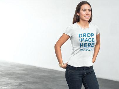 T-Shirt Mockup of a Young Woman Walking Down a Corridor 6579a
