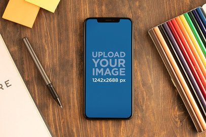 Mockup of an iPhone XS Max Surrounded by Office Supplies 25390
