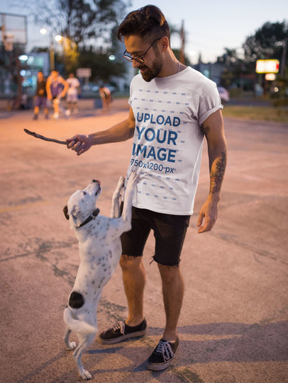 T-Shirt Mockup of an Edgy Man Playing with His Dog 18030
