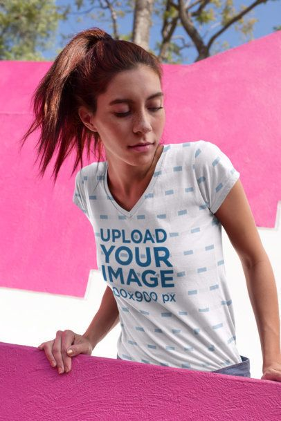 Sublimated V-Neck Tee Mockup of a Freckled Girl Looking down a Balcony 24981