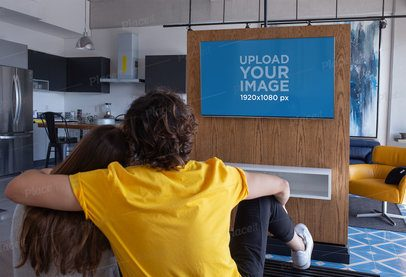 Mockup of a Couple Watching Tv in a Modern Flat 25837