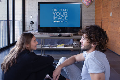 Mockup of a Man and a Woman Chatting in Front of the TV 25845