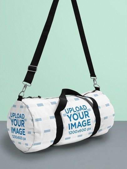 Duffle Bag Mockup Hanging Inside a Bright-Colored Setting 25169