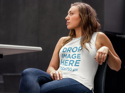 Tank Top Mockup of a Woman Sitting Outside at a Café 6390a