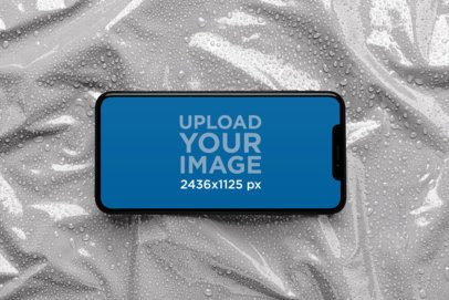 iPhone XS Mockup over a Wet Plastic Surface 25968