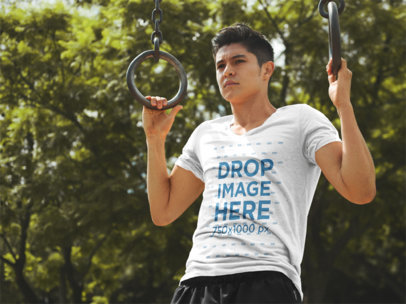 T-Shirt Mockup of a Man Exercising on Gymnastic Rings 5559