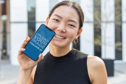 iPhone XS Mockup Featuring a Smiling Pretty Girl 25764